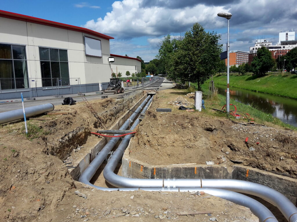 Pipelines steel silver color large diameter for conveying medium embedded in the ground in the city, image